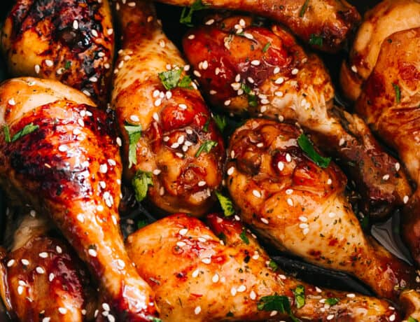 close up of chicken drumsticks glazed with honey sriracha sauce
