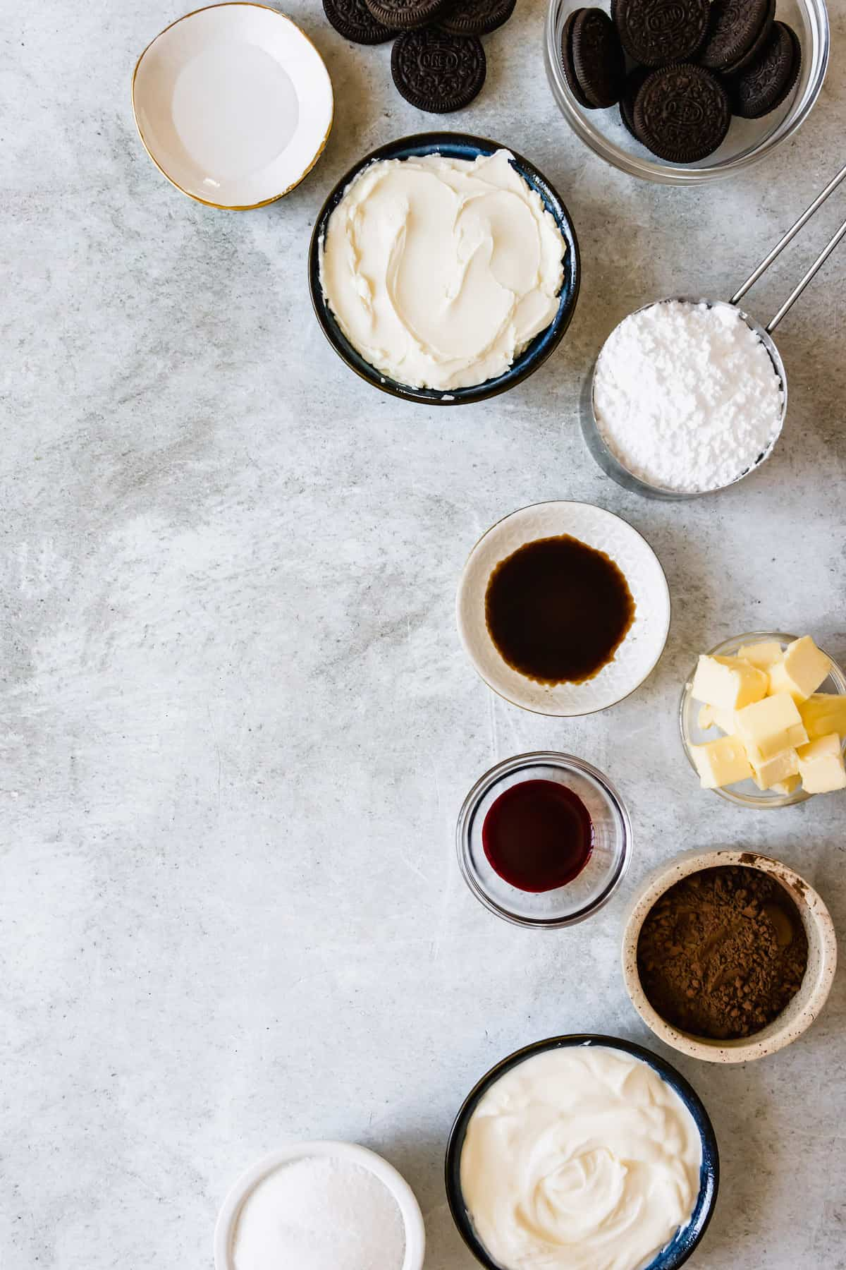 The Red Velvet Cheesecake Ingredients Assembled on a Light Gray Marble Counter