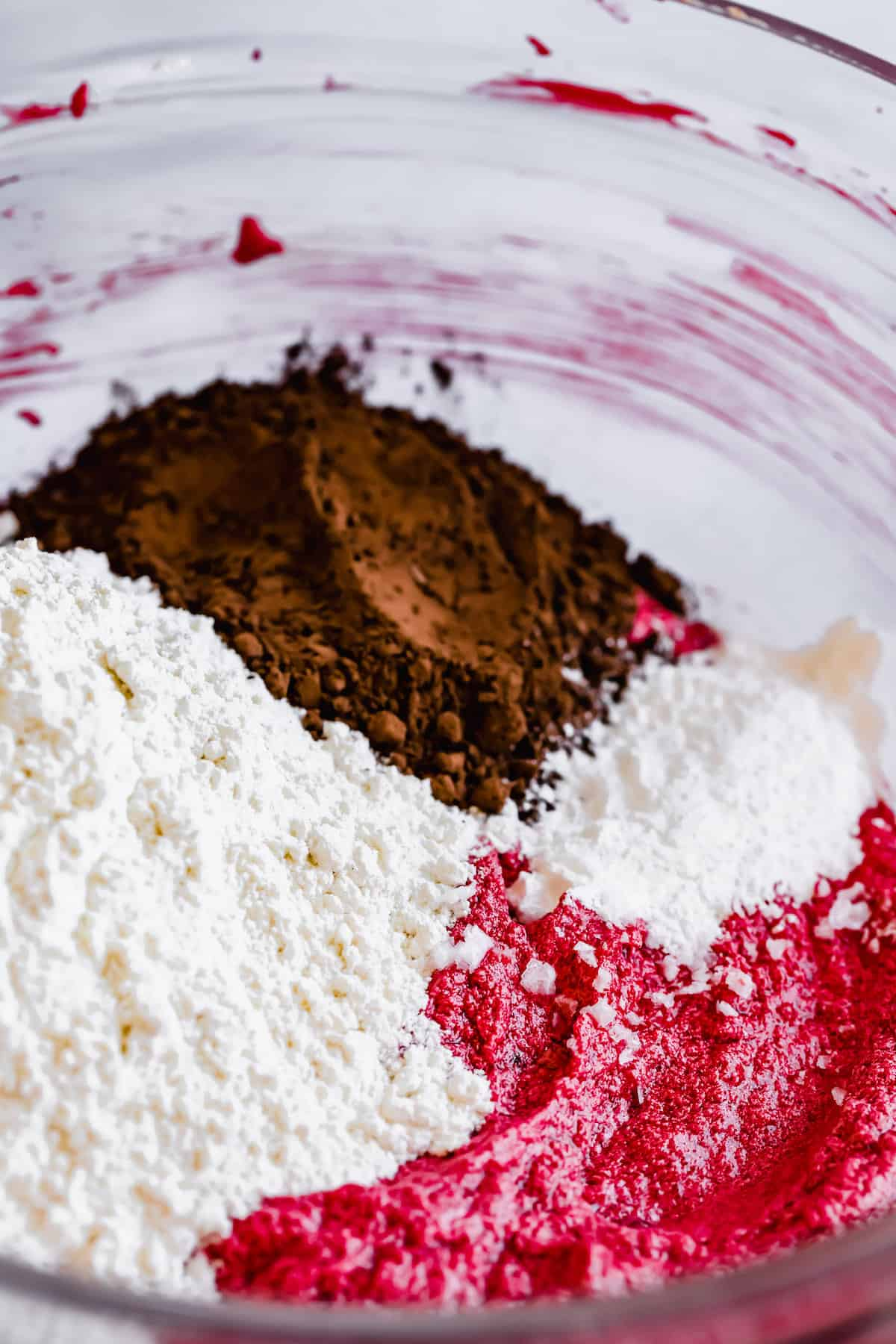 The Dry Ingredients in a Bowl with the Combined Wet Ingredients for Red Velvet Crinkle Cookies