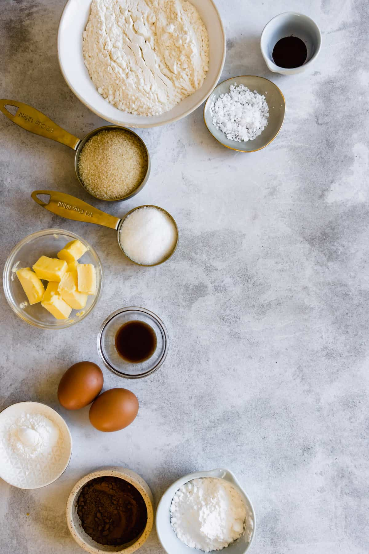 Eggs, Vanilla, Butter, Flour and the Remaining Cookie Ingredients on a Countertop