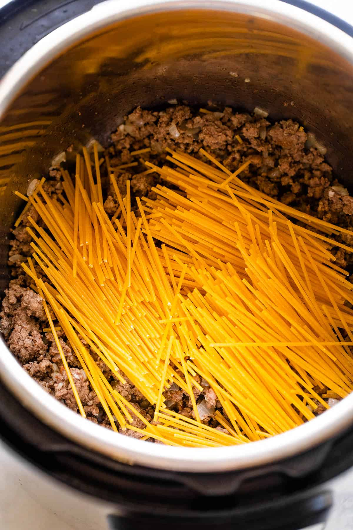 dry spaghetti set over ground beef in the instant pot