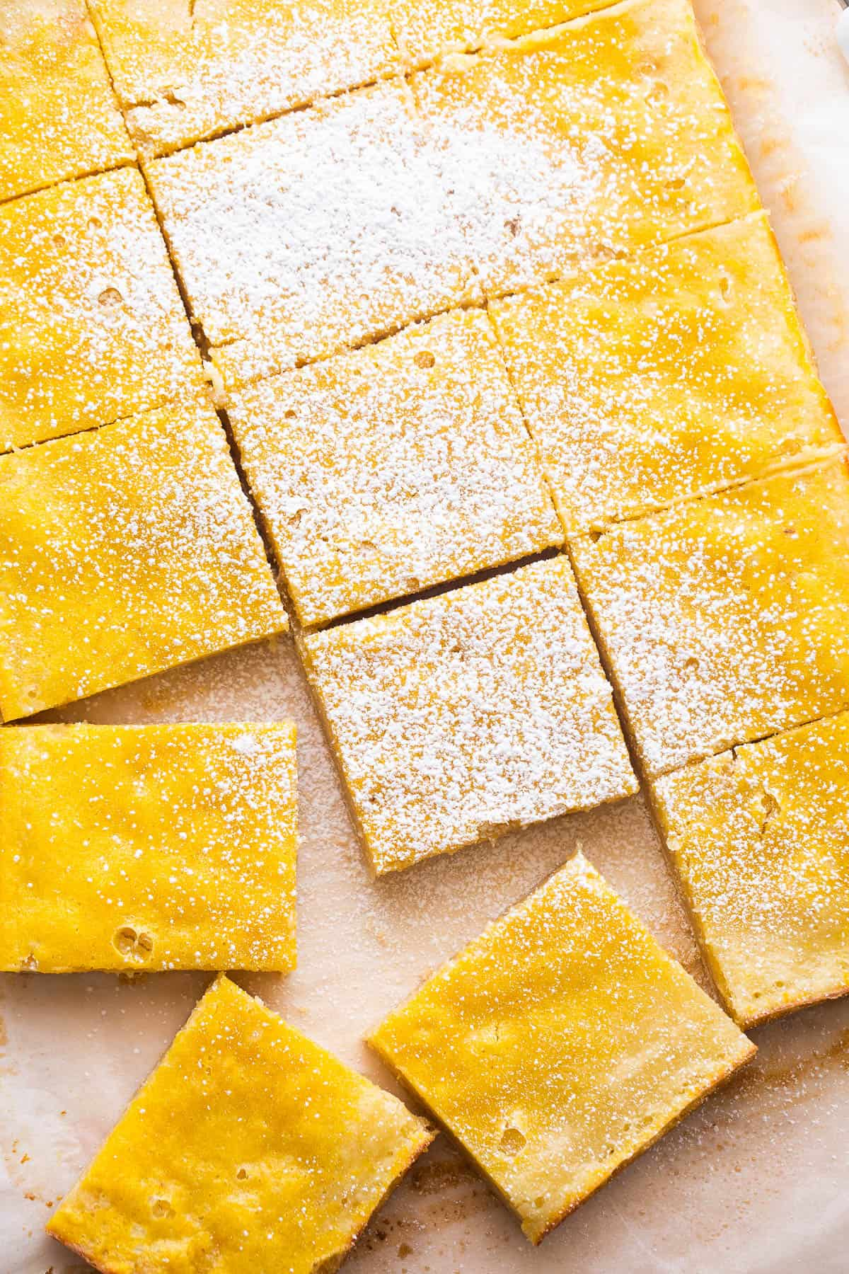overhead shot of cut lemon squares dusted with powdered sugar
