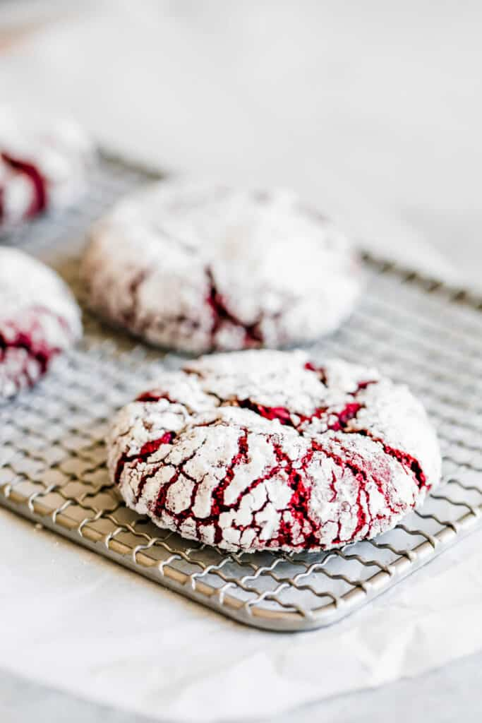 Four Red Velvet Cookies on Top of a Small Cooling Rack