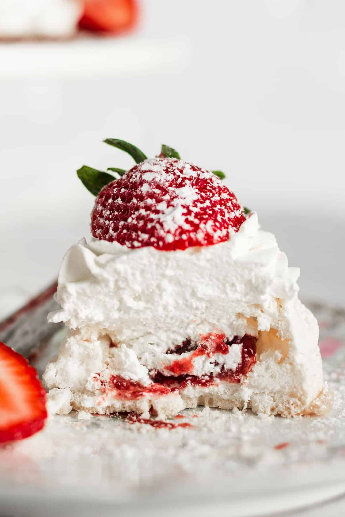 The inside of a pavlova with strawberry jam