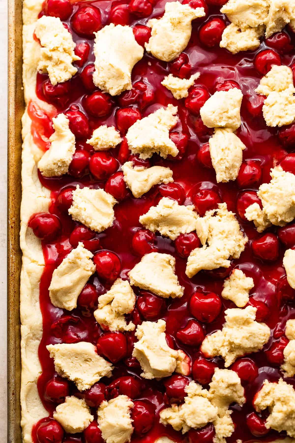 Scoops of Dough Overtop Cherry Pie