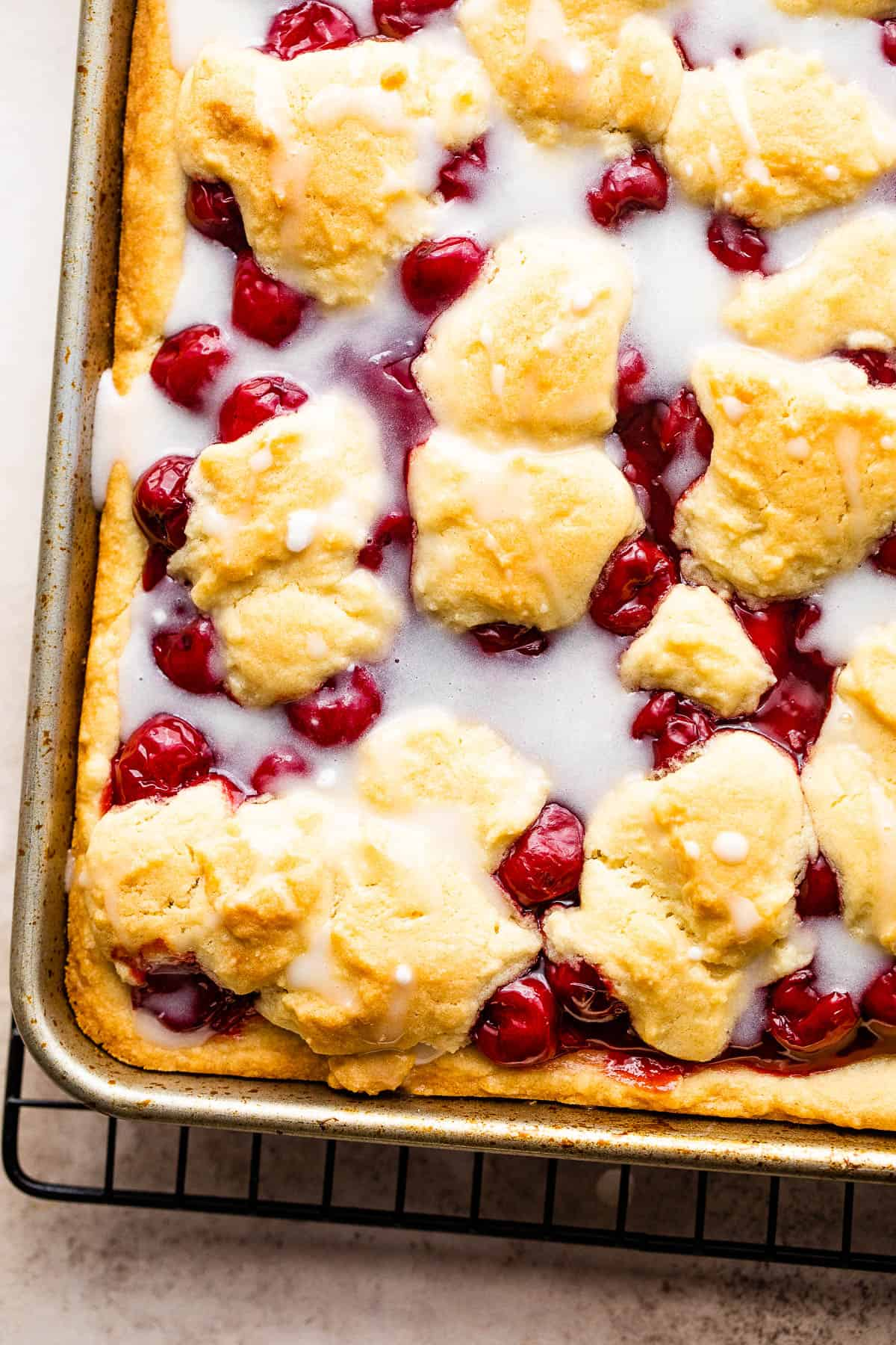 A Pan of Cherry Kuchen Bars Drizzled with Homemade Icing