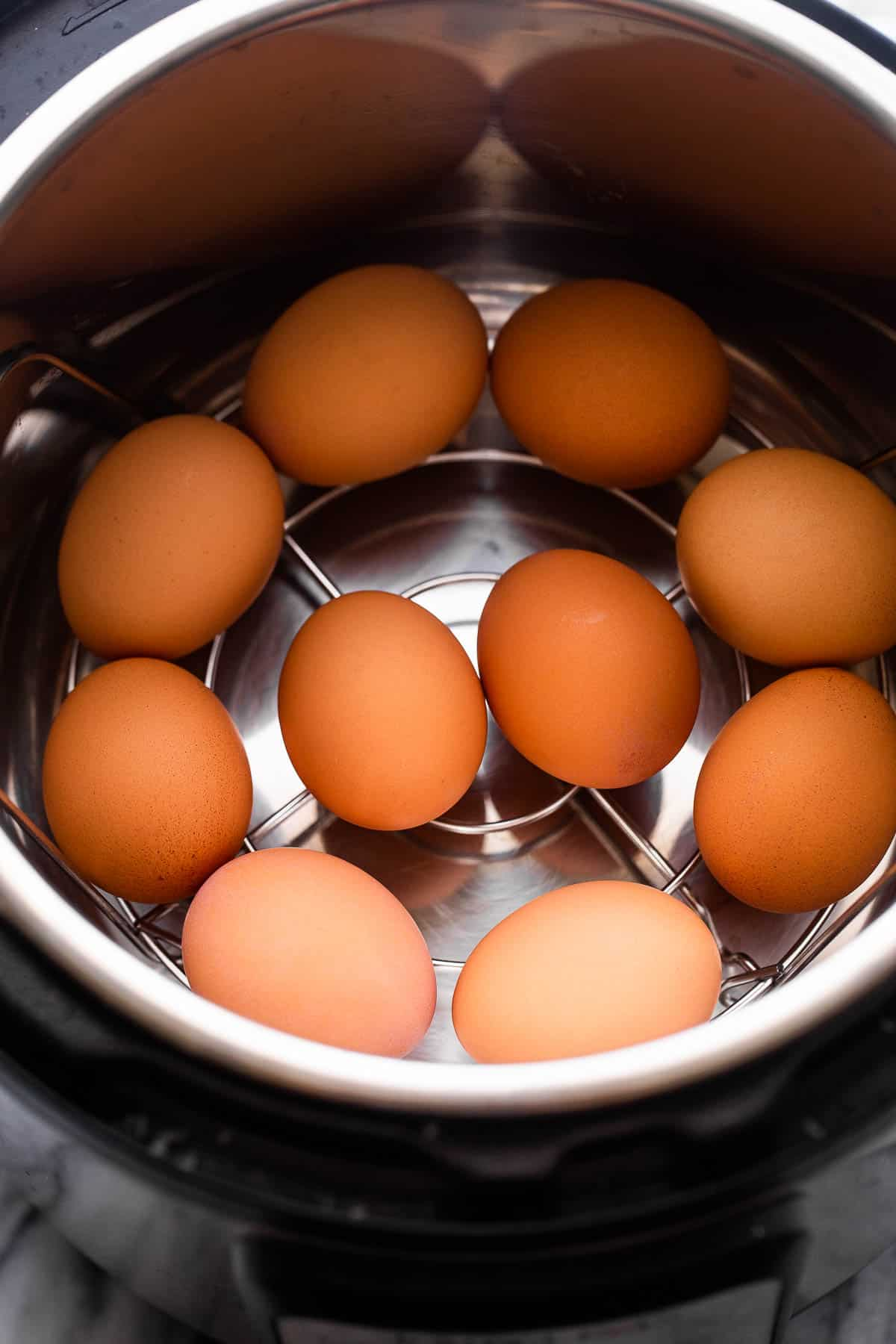 brown eggs arranged inside the instant pot