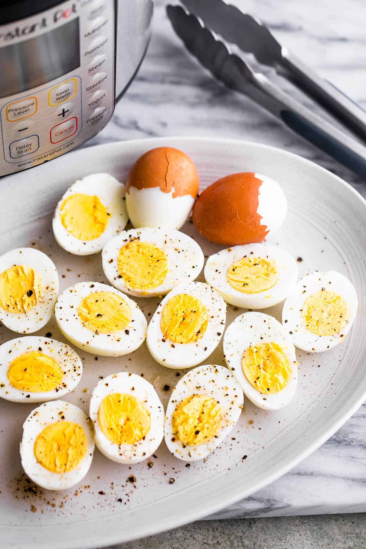 instant pot pressure cooked and a plate of hard boiled halved eggs