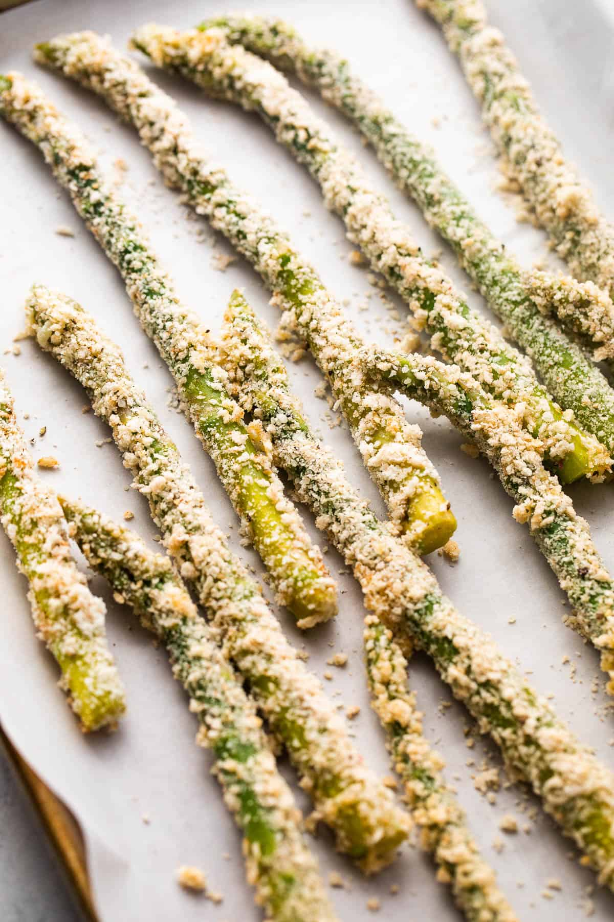 arranged fresh asparagus spears coated with parmesan panko crumbs
