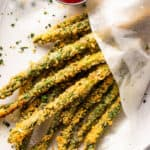 overhead shot of baked parmesan panko asparagus fries served with ketchup on the side
