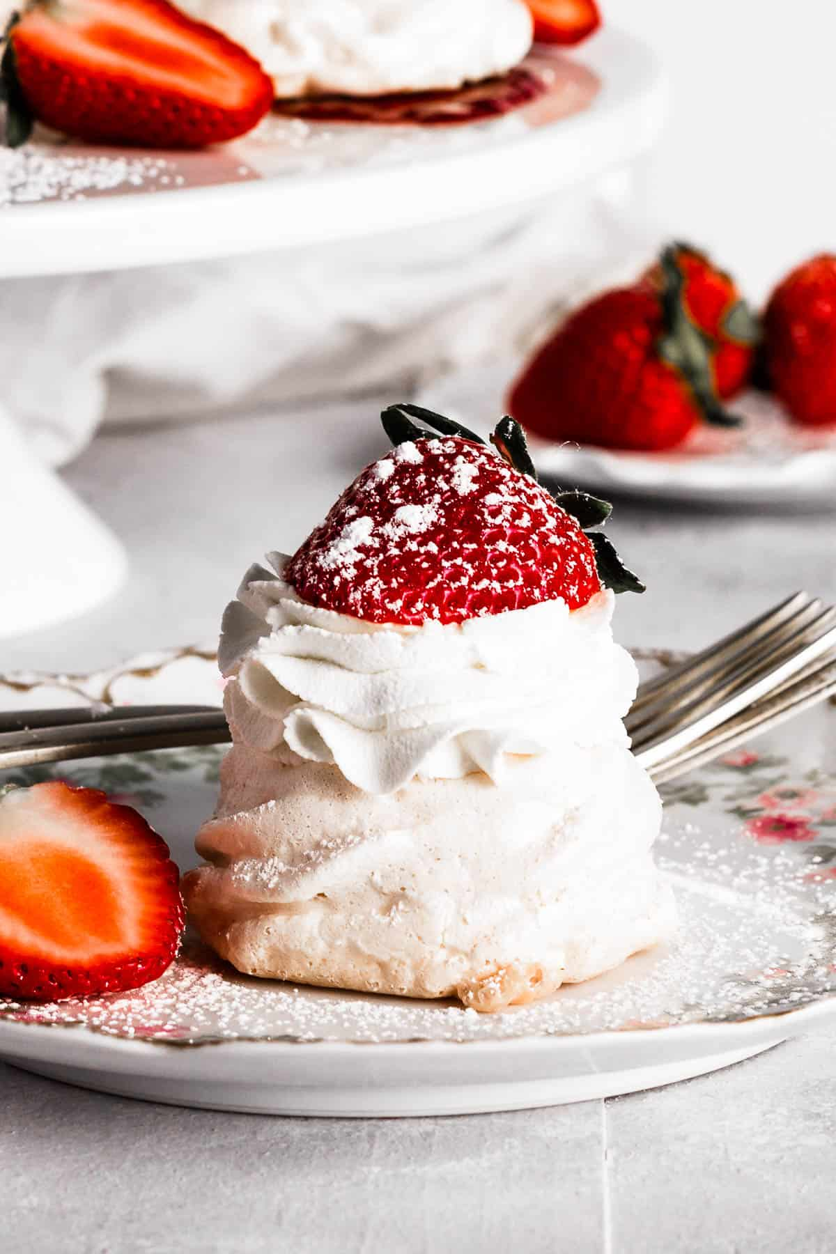 A mini pavlova on a plate with strawberries