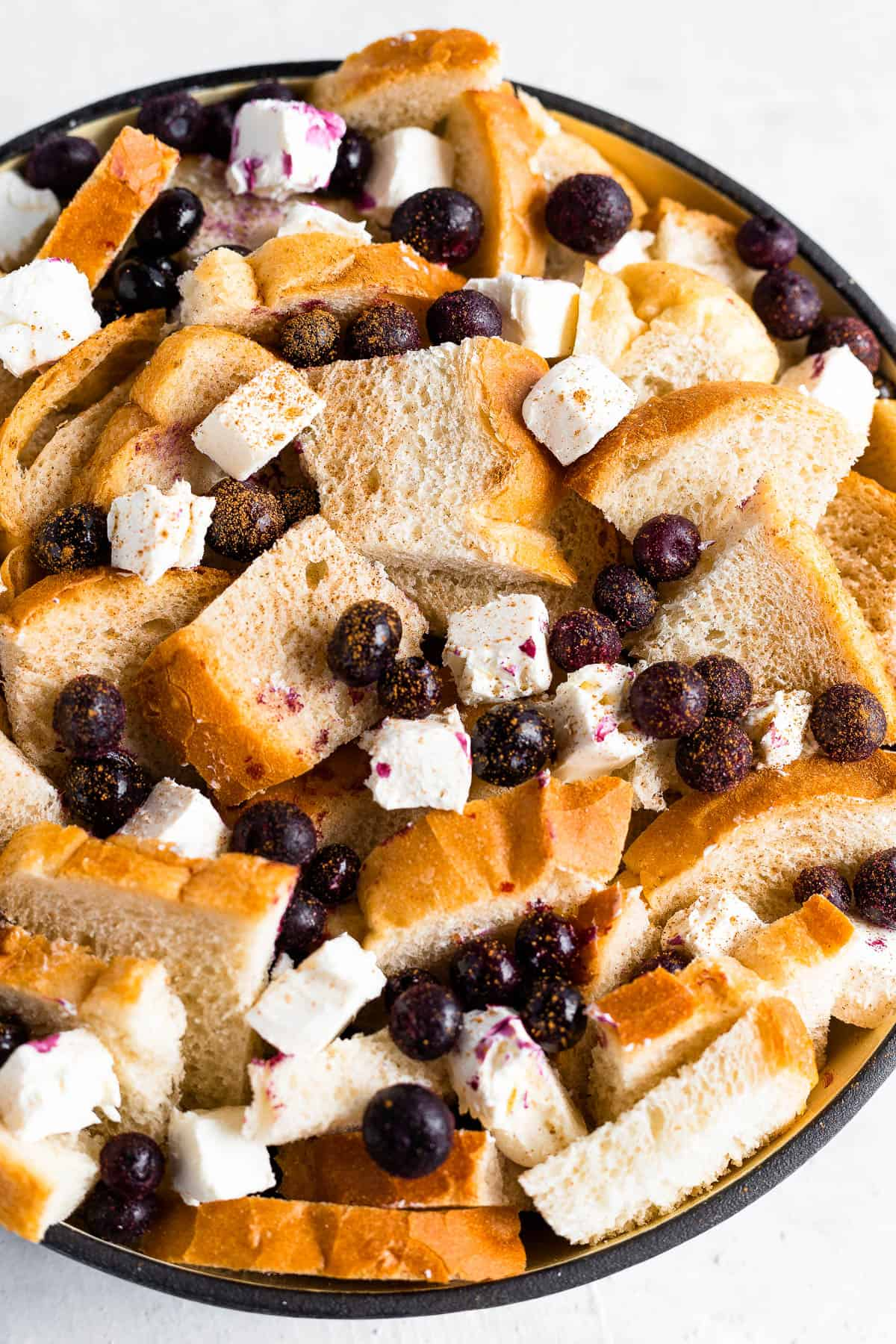 Cubed Sourdough Bread, Blueberries and Cream Cheese Cubes in a Black Bowl