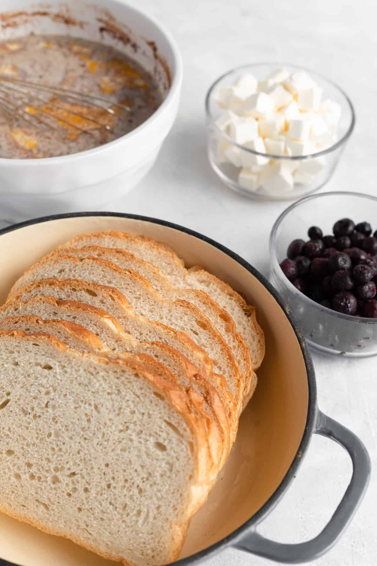 Sourdough Bread, Cream Cheese, Blueberries and the Rest of the Casserole Ingredients on a Countertop