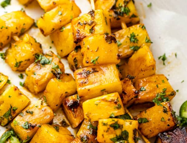 grilled tequila pineapple skewers served on a plate