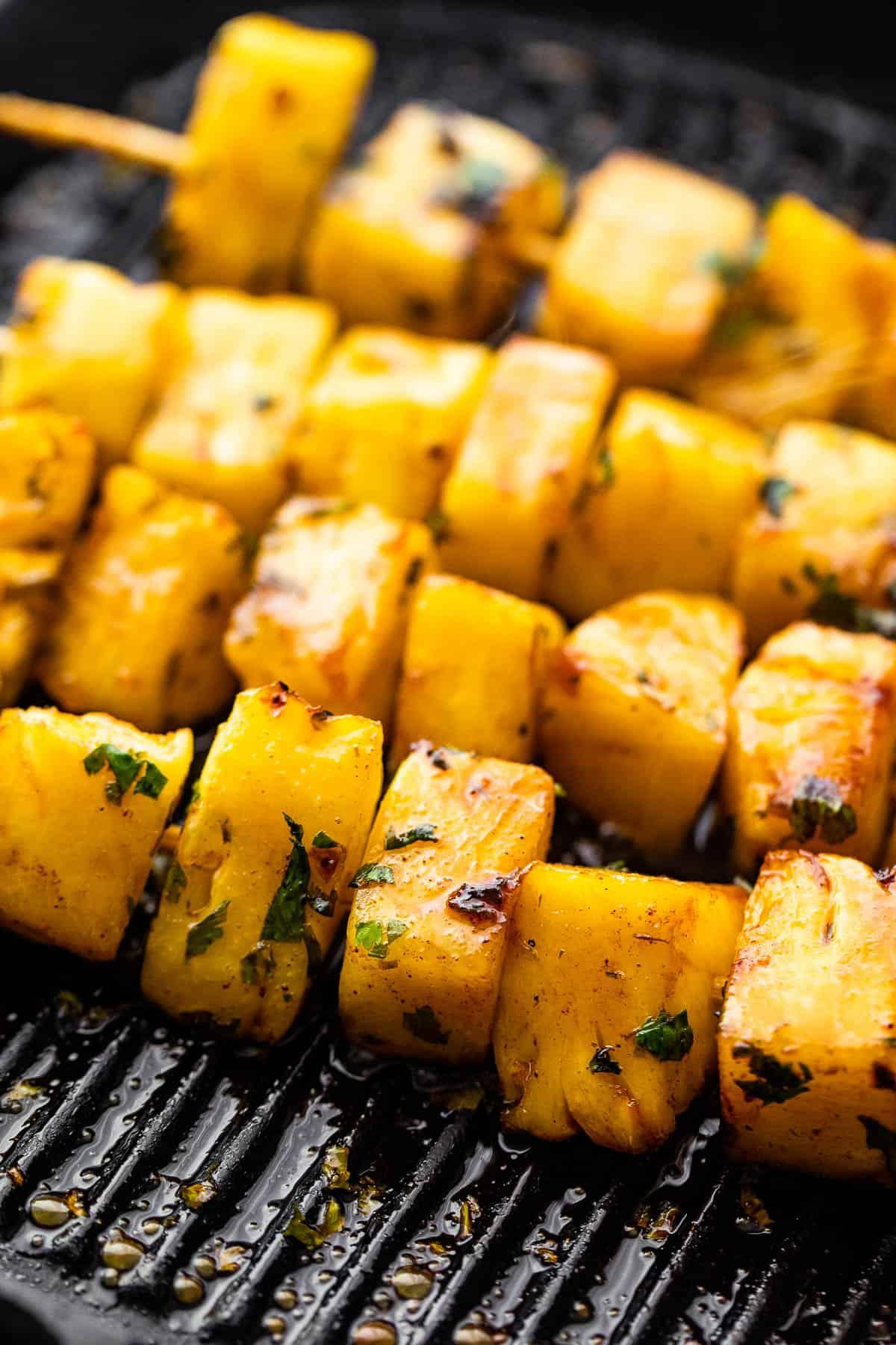 grilling pineapples on skewers