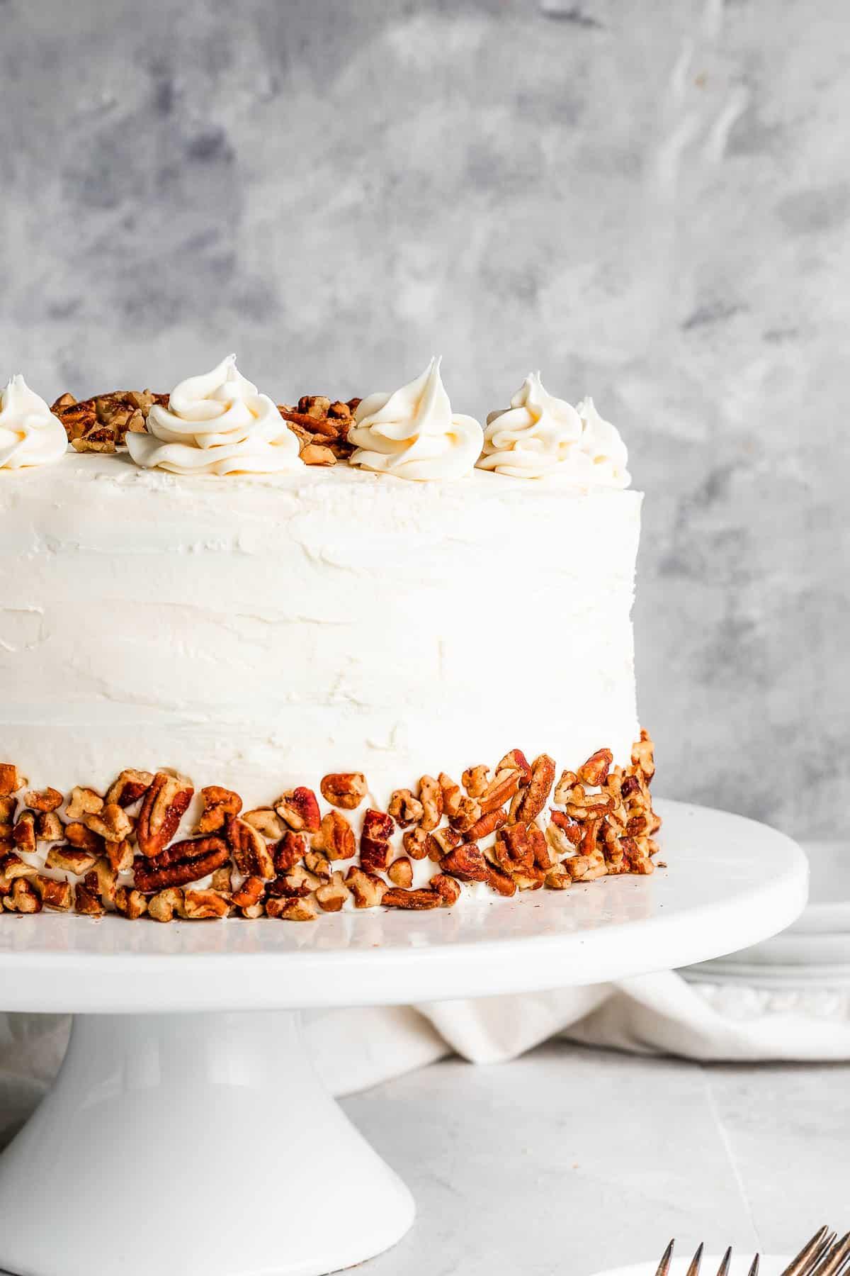 hummingbird cake on a white cake stand