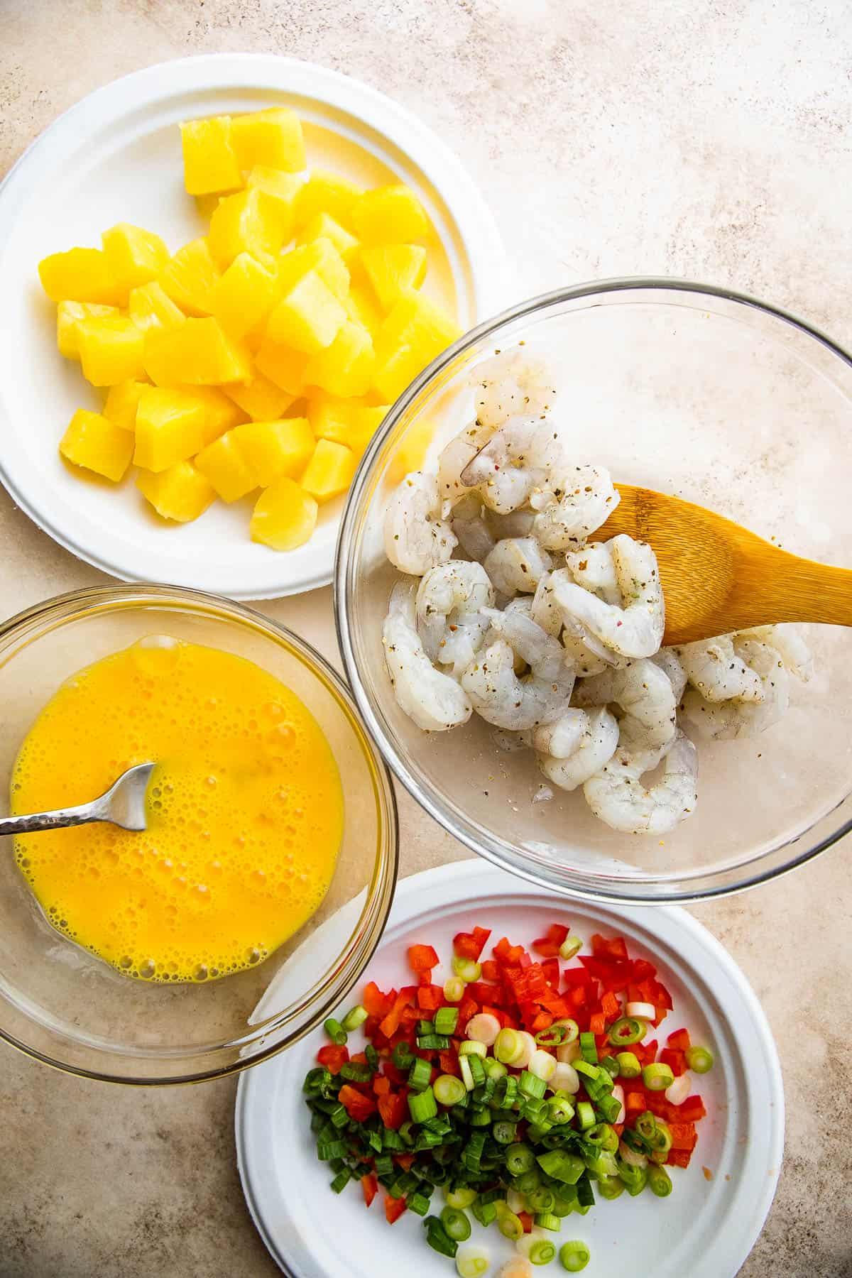 shrimp fried rice ingredients in bowls