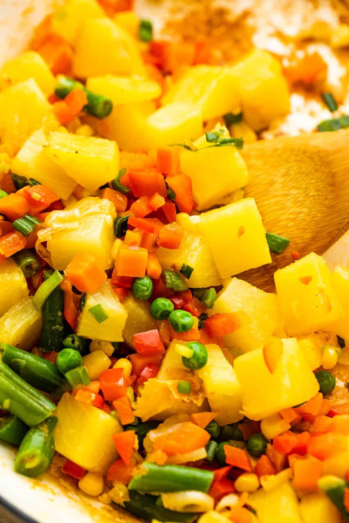 cooking pineapple chunks with veggies