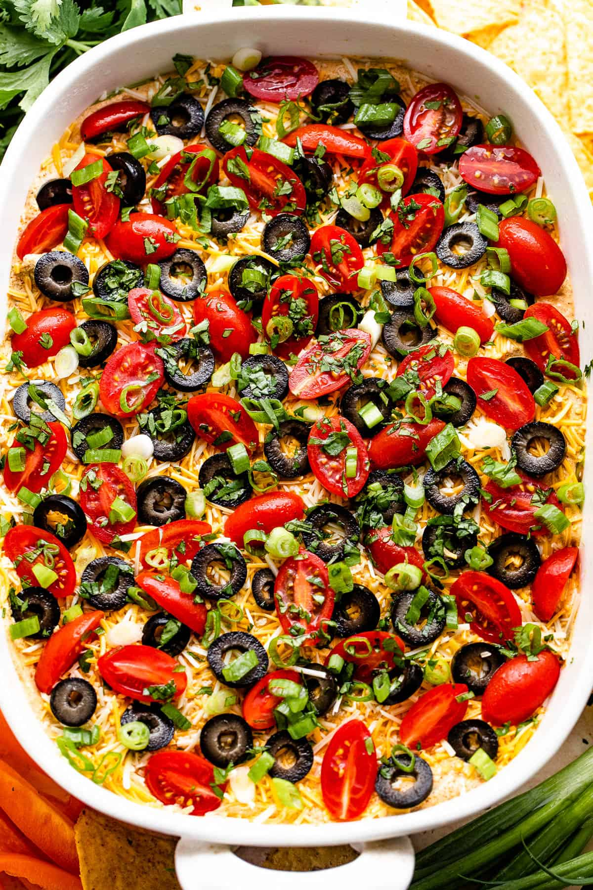 overhead shot of a white baking dish with seven layer mexican dip