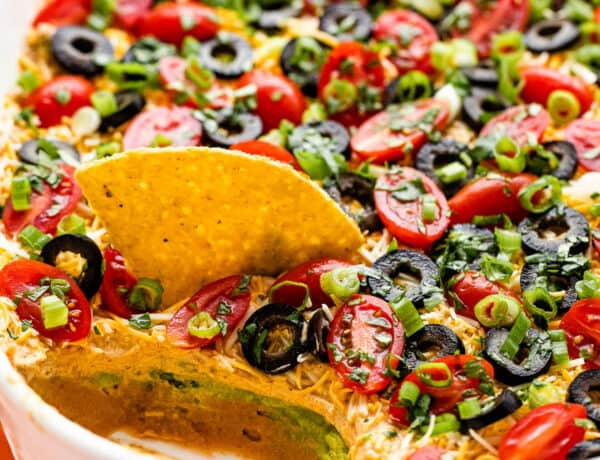 side shot of a white baking dish with seven layer mexican dip