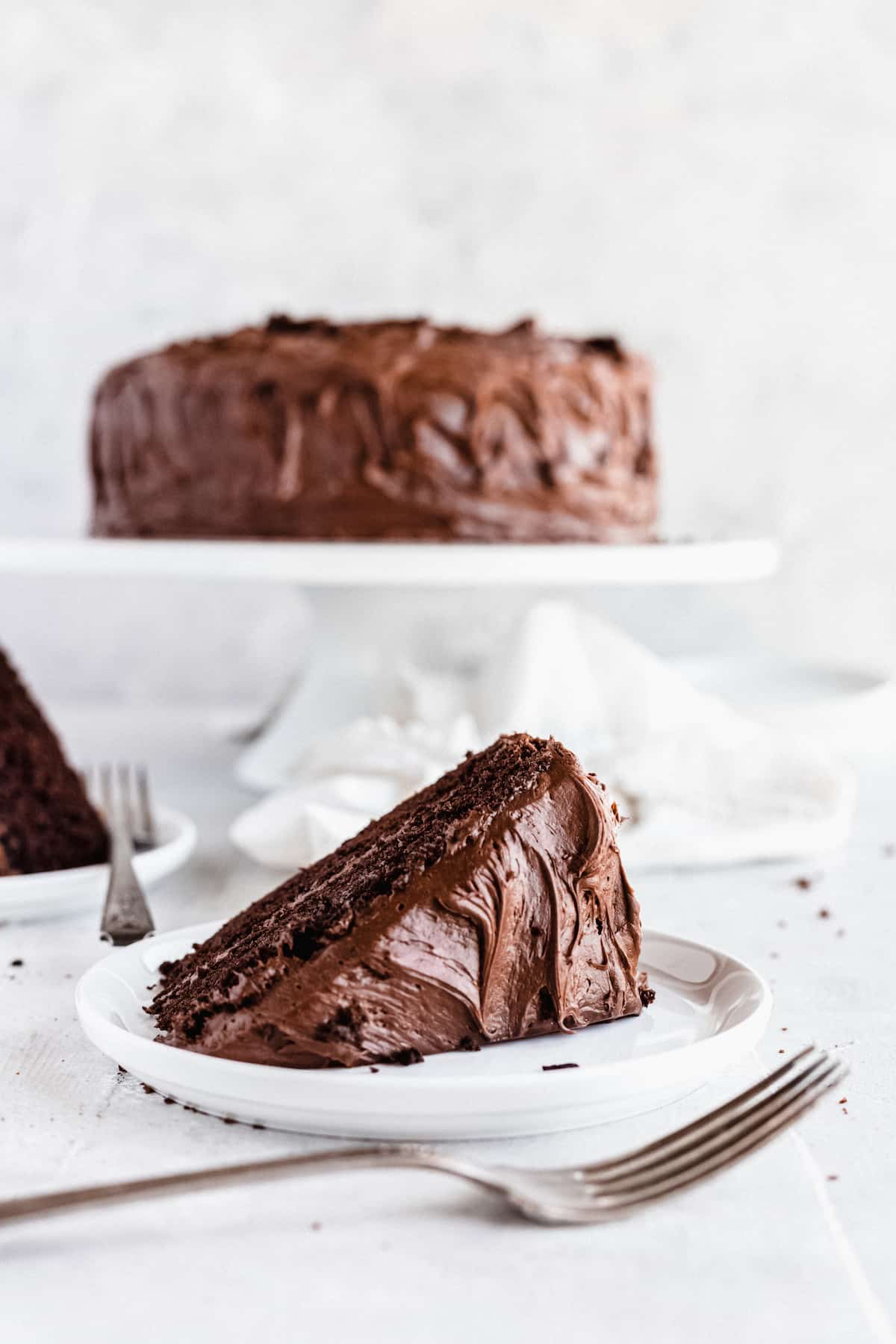 A Sideways-Lying Slice of Chocolate Cake on a Countertop with a Fork