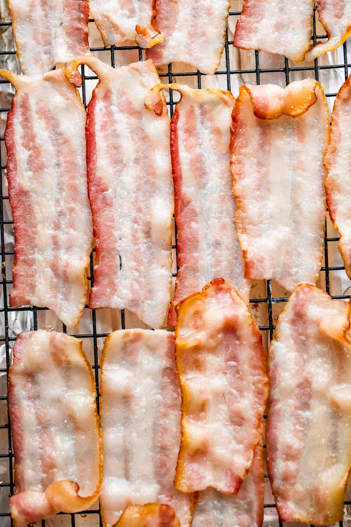 bacon slices arranged on top of baking rack