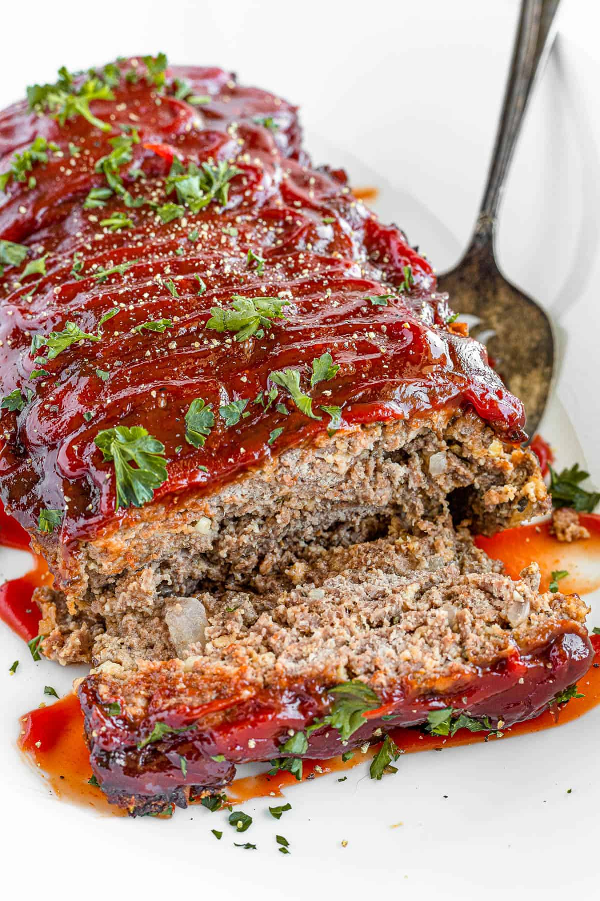 A Plate Full of Meatloaf with One Slice Removed