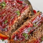 Meatloaf Covered in Barbecue Sauce on a White Serving Platter