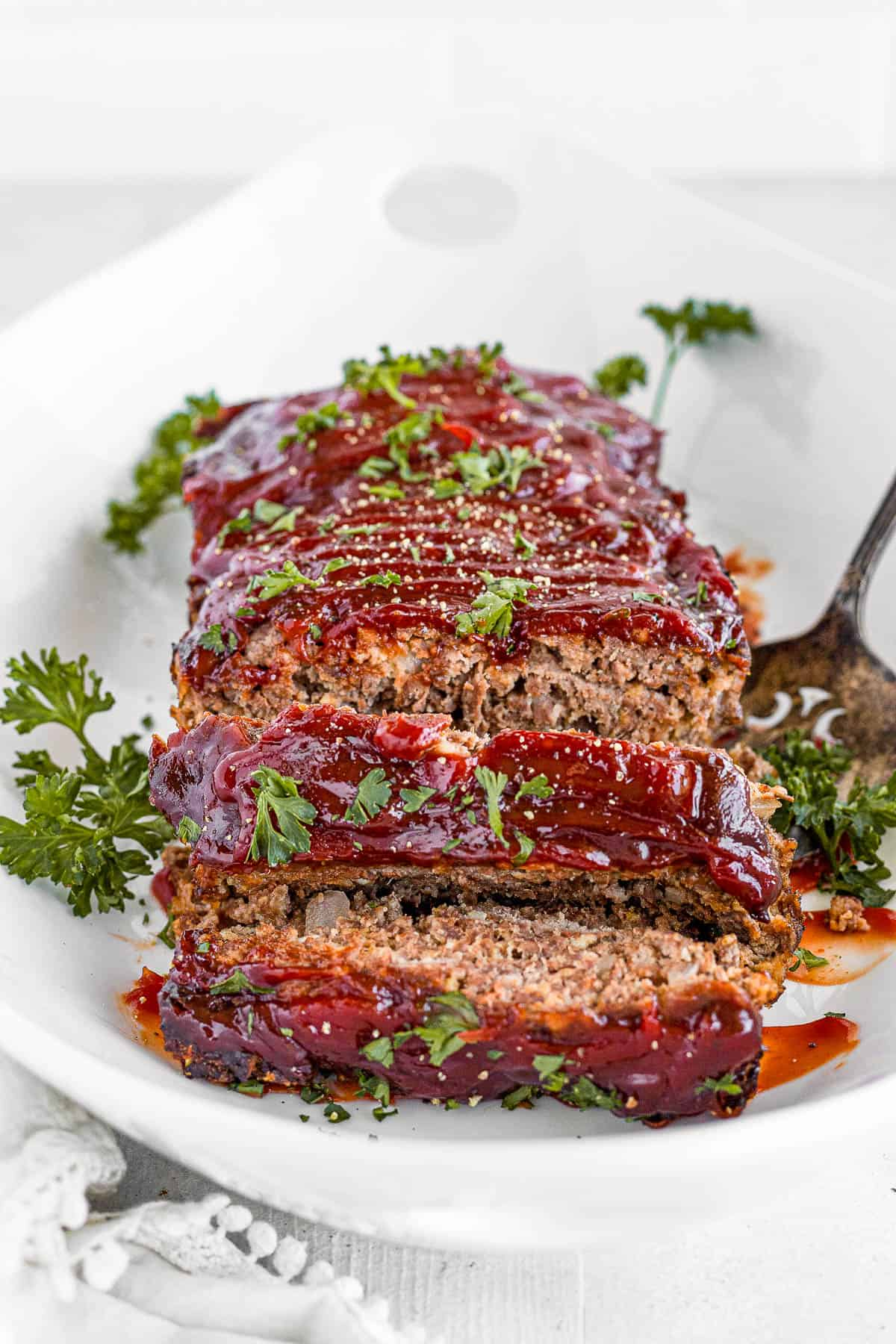 A Plate of Homemade Meatloaf Garnished with Fresh Chopped Parsley