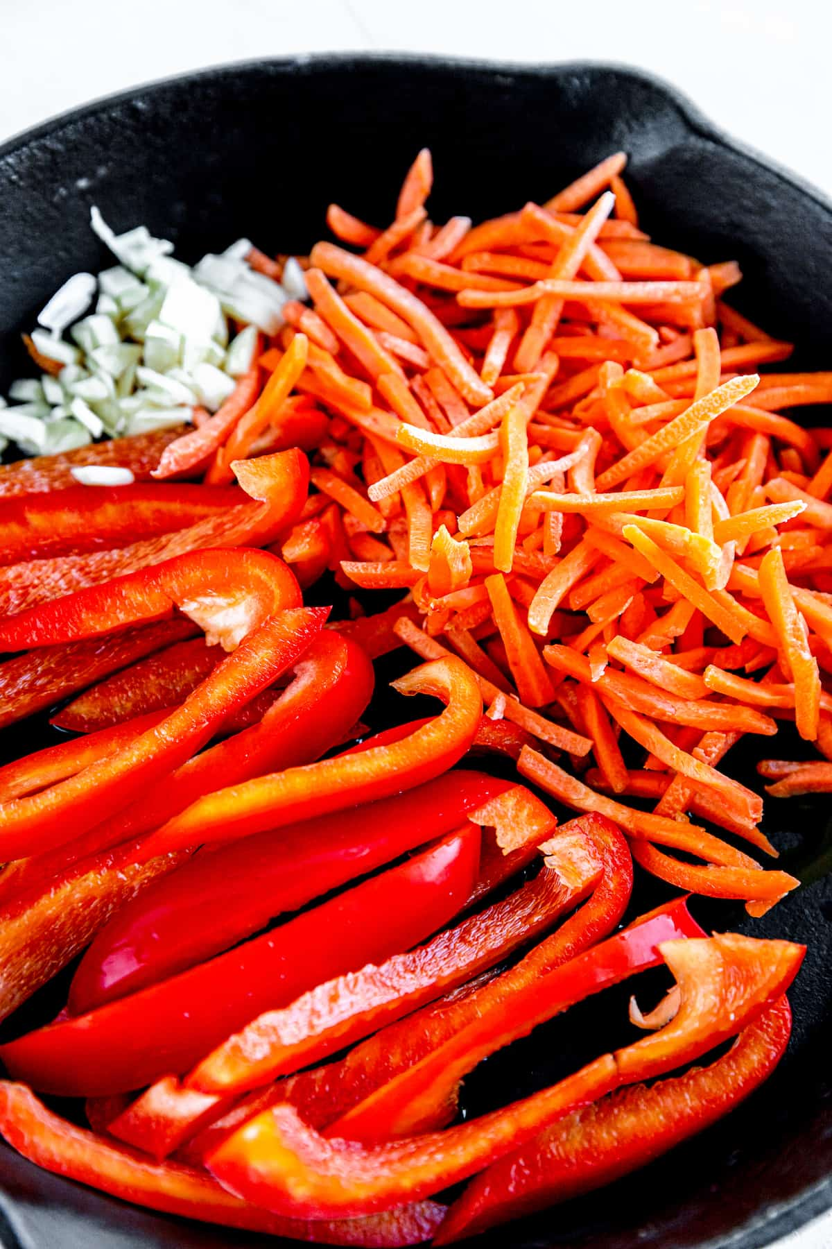 Raw Bell Peppers, Bean Sprouts and Shredded Carrots in a Skillet