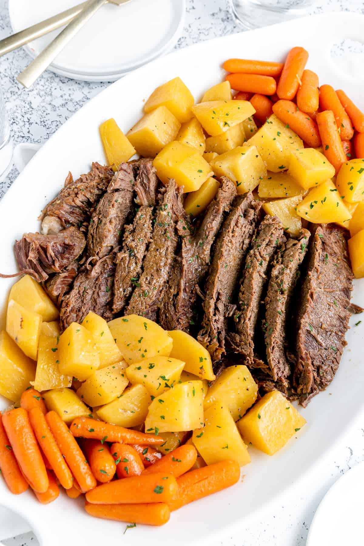 Pot roast, potatoes and carrots on a plate
