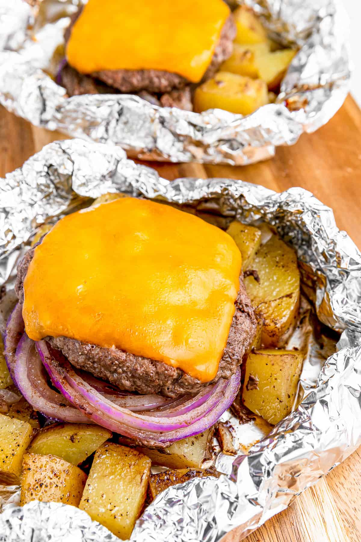 Cheeseburger in foil with melted cheese