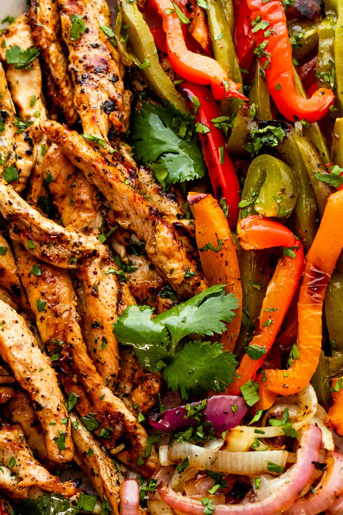 close up photo of grilled chicken and bell peppers for grilled chicken fajitas