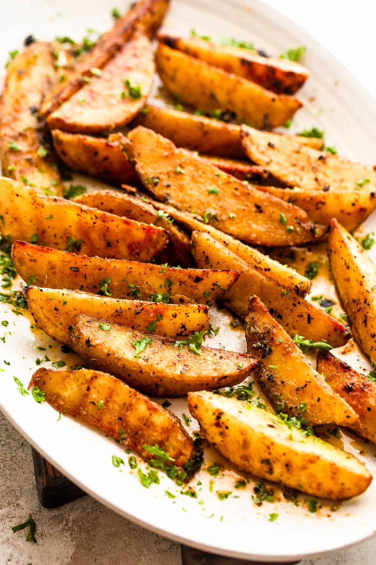Grilled Potato Wedges served on a white oval platter