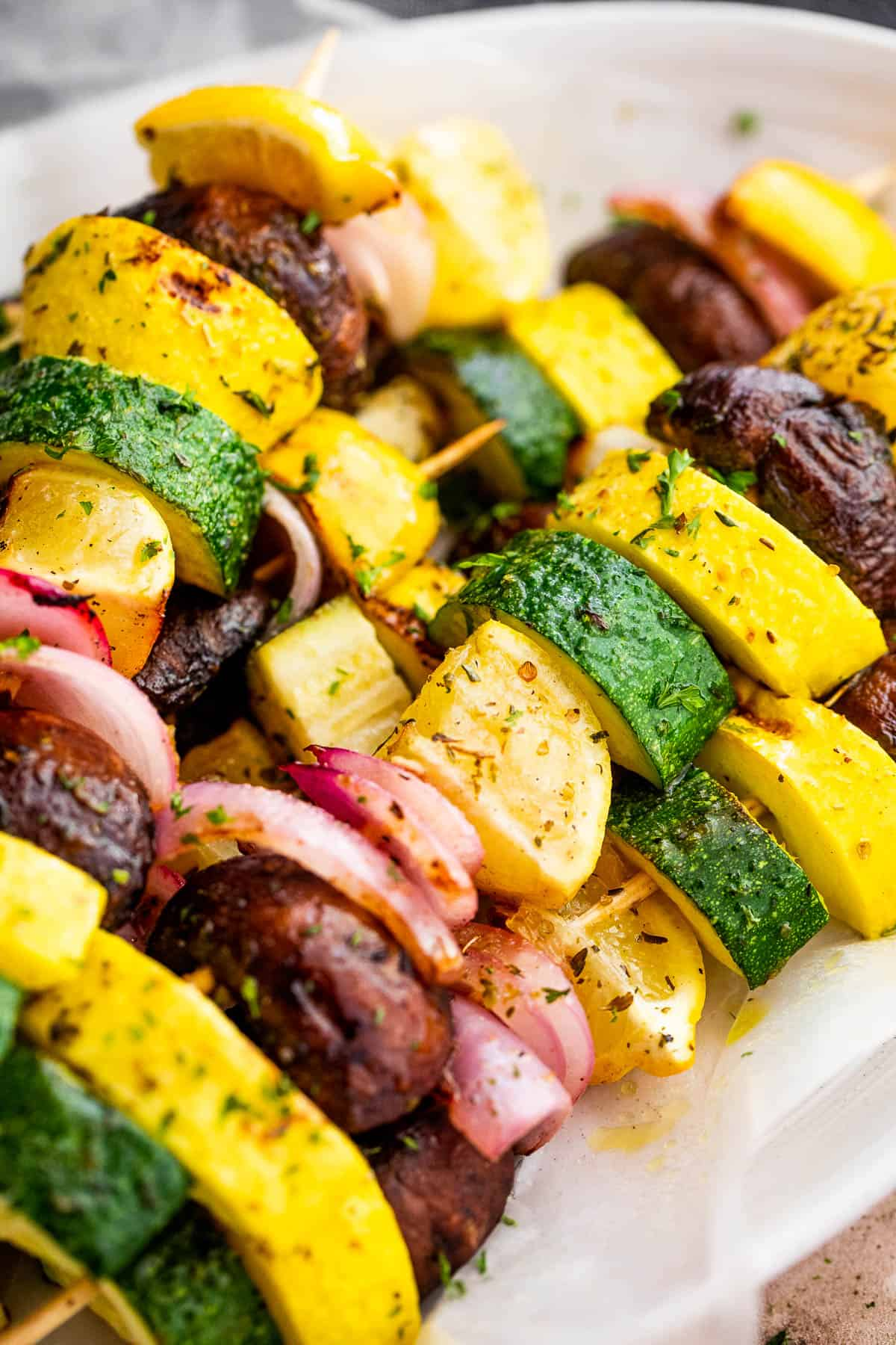side shot of plated grilled squash skewers