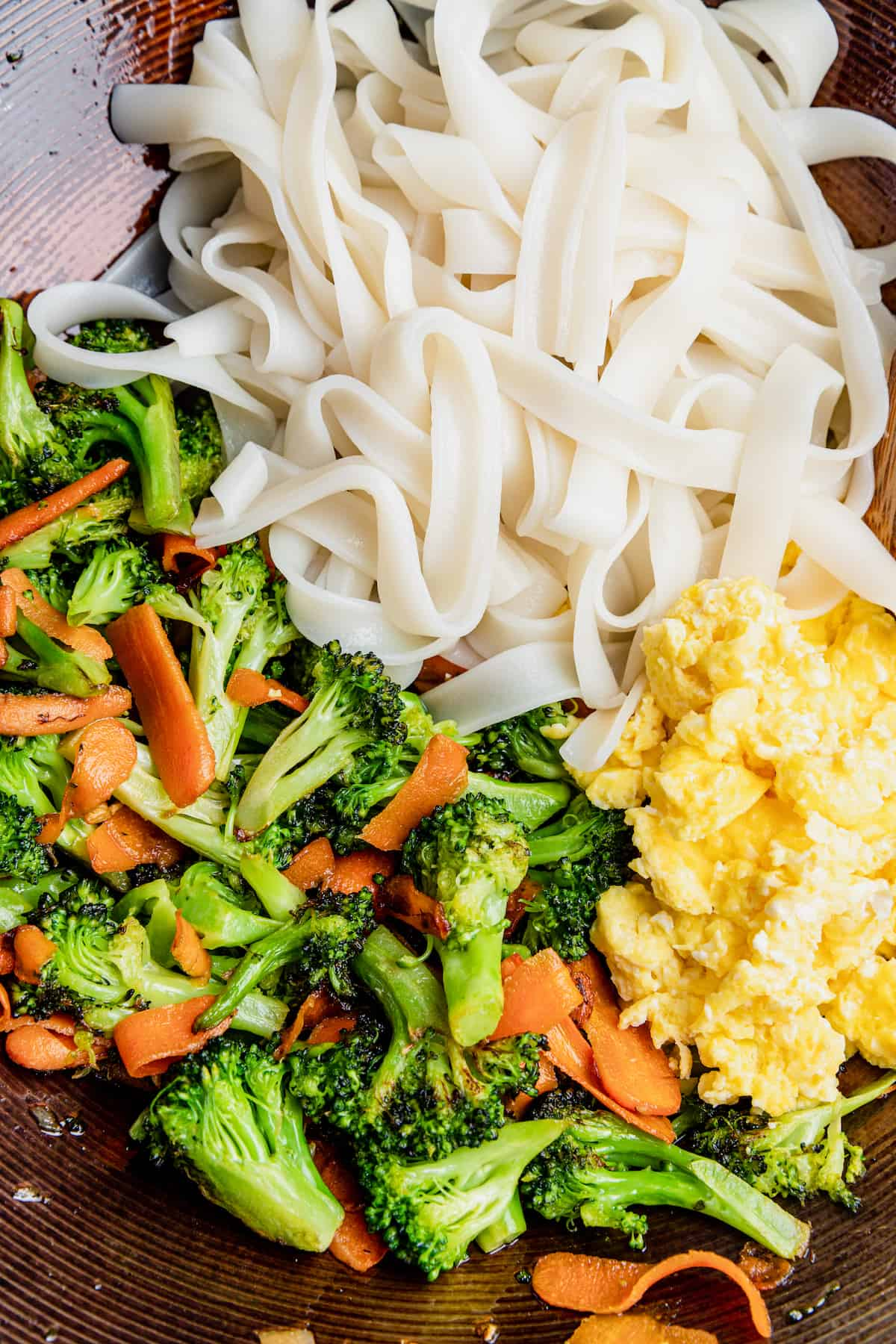 A Bowl of Cooked Rice Noodles, Eggs and Vegetables