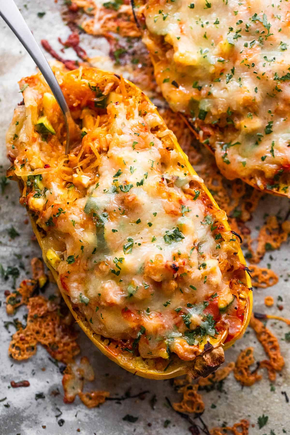 spaghetti squash stuffed with chicken enchilada filling and topped with melted cheese