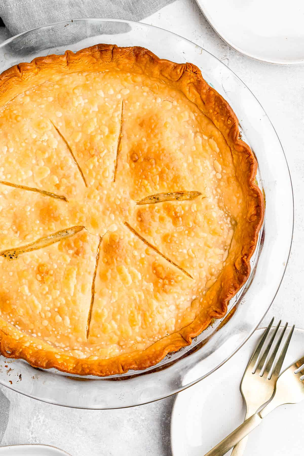 Baked chicken pot pie with slits cut into the top crust for venting.