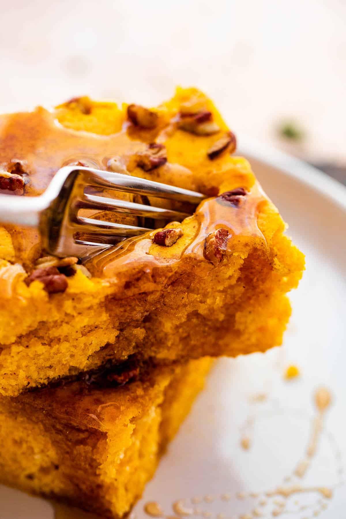 fork cutting into a pumpkin pancake